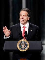 Gov. Andrew Cuomo speaks as he introduces President