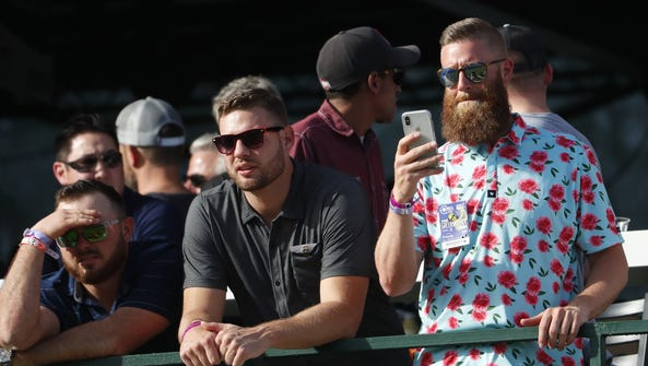 Diamondbacks pitcher Archie Bradley (R) watches Rickie