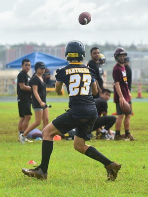 Guam High School sophomore Brendan Squazza participates in a receiving drill during the Integrity Scouting Report Evaluation Camp at John F. Kennedy High School in Tumon on Aug. 6.