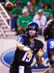 MTSU quarterback John Urzua makes a throw against Marshall