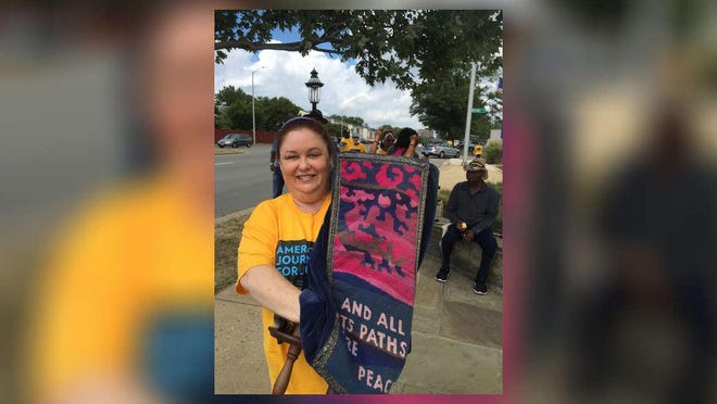 Rabbi Cookie Lea Olshein carries a Torah in a NAACP march through Virginia in 2015.