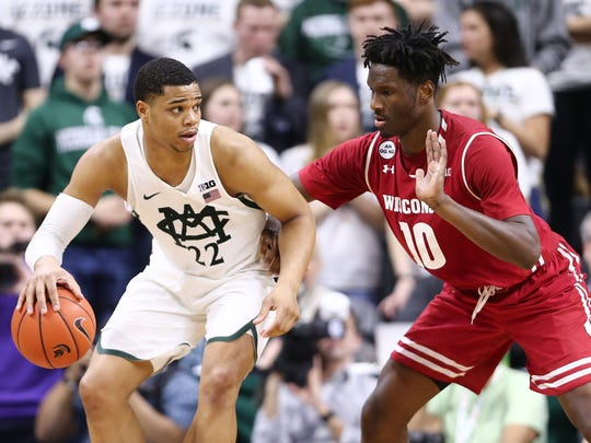 Miles Bridges of the Michigan State Spartans handles the ball as Nigel Hayes of the Wisconsin Badgers defends during the second half at the Breslin Center on Feb. 26, 2017 in East Lansing.