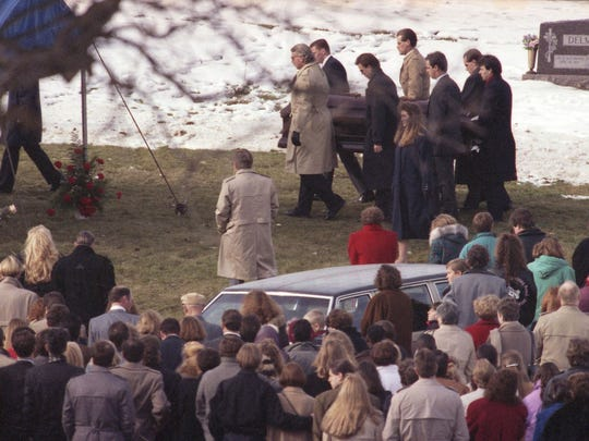 The casket of Cara McGrane, who was shot and killed Nov. 29, 1992 at Drake Diner, is carried to her burial site on Dec. 3, 1992.