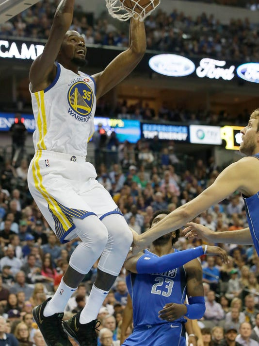 ce6ad939fd4 Golden State Warriors forward Kevin Durant (35) scores in front of Dallas  Mavericks forward