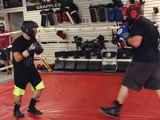In this Oct. 4, 2017 photo, West Virginia University boxer Steven Ware, left, spars with Craig Frazee at gym in Morgantown, W.V. Ware in April won the National Collegiate Boxing Association 132-pound championship, which he plans to defend. (AP Photo/S.M. Christman)