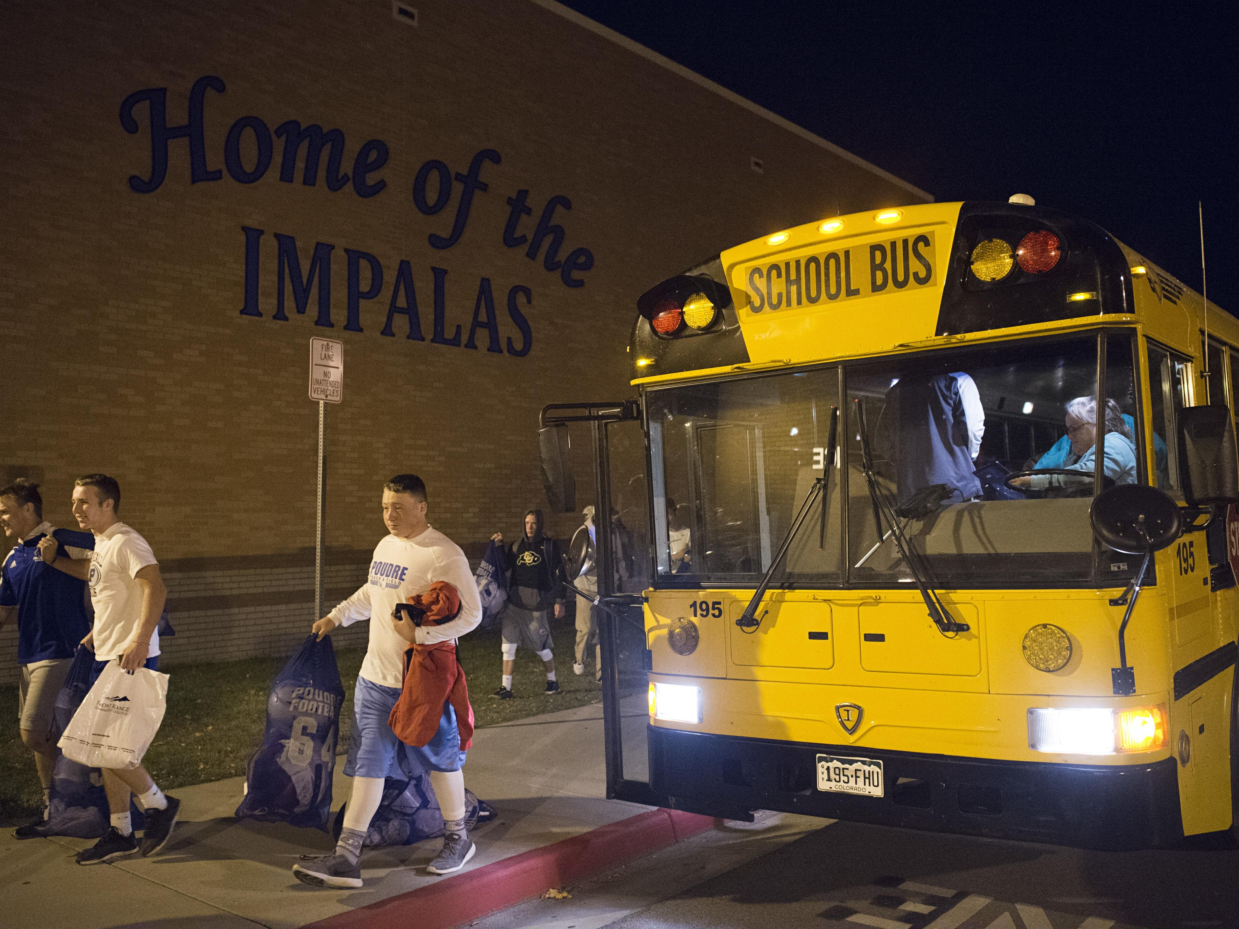 11:35 p.m. - The Poudre High School football team arrives back home following a game against Legend High School in Parker, a nearly 90-mile bus ride, Thursday, October 13, 2016.
