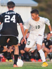 Parkside midfielder Jarod Ramses (10) works past Easton midfielder Ladd Griffin in a Bayside title game at County Stadium on a Tuesday night in 2014.