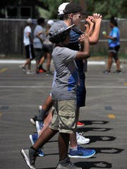Freshmen clarinet player Mike Blanco IV and trombonist Brent Bardin march with their squad Friday July 28, 2017 as they practice drills with the Eagle Band at Abilene High School.