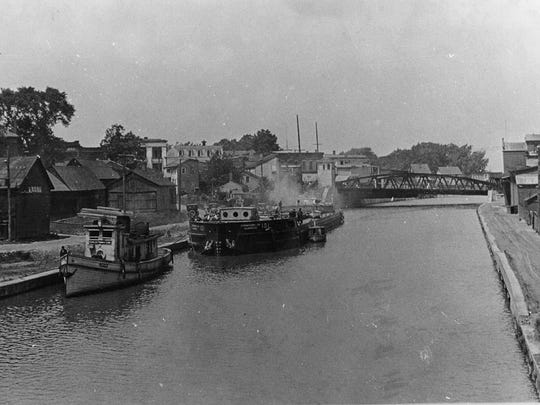 The view in this 1922 photo is looking west, with the Main Street lift bridge in view.