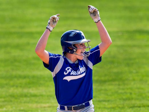 Franklin Central High School's Raegan Sparks (14) reacts at second base after knocking in two runs off of a double to put the team on the board. Franklin Central and Greenwood high schools faced off Monday, May 26, 2014, in the opening game of 2014 IHSAA Girls' Softball Sectional action at Franklin Community High School. Franklin Central defeated Greenwood 4-2 in 14 innings.
