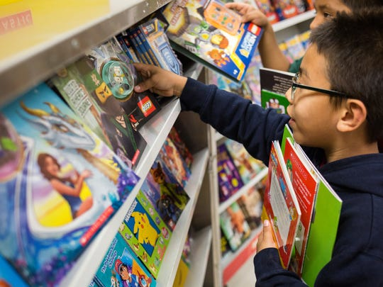 The Gift of Reading Book Fair shown, in this photo at the Highland Elementary School in Immokalee, is just one example of many of how the Immokalee Foundation provides resources and support for young people throughout Southwest Florida.