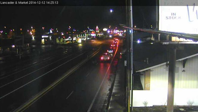 The image shows traffic at Lancaster Drive and Market Street.