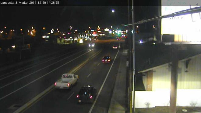 The image shows traffic at Lancaster Drive and Market Street NE.