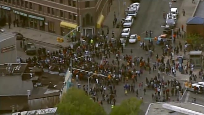 People gathering in the streets of Baltimore, Md.