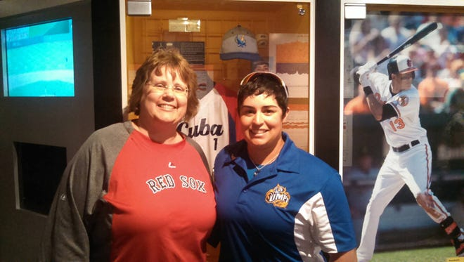 Oz Sailors, right, had her college hat and game ball inducted into the National Baseball Hall of Fame and Museum recently. Sailors will host a free women's baseball clinic on Guam this week.