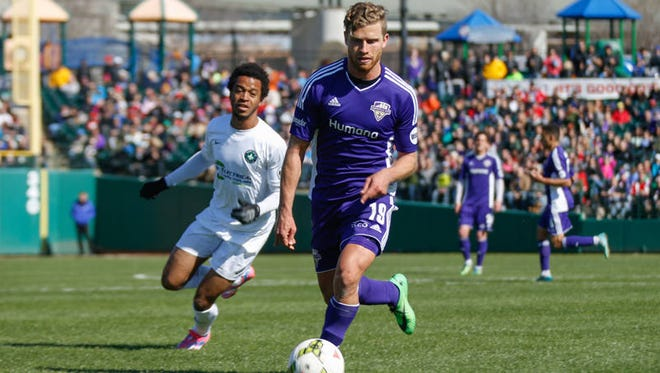 Guy Abend dribbles up field in Louisville City FC's opener March 28.