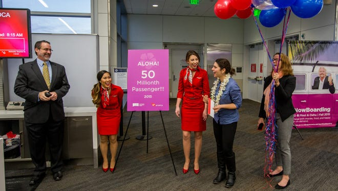 SFO Airport and Virgin America presented the airport's 50 millionth passenger of the year with two round-trip tickets to Hawaii.