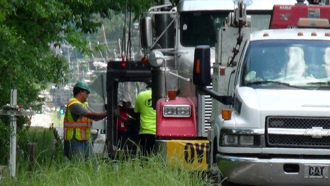 Construction begins on a Hanging Moss Road bridge Tuesday.