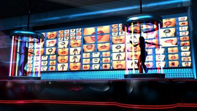 Kiss Kiss a Go Go dancers will perform atop a 50-foot bar.