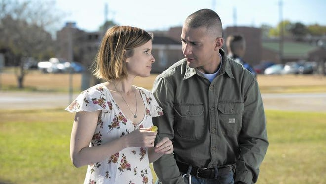 """This image released by Lionsgate shows Kate Mara, left, and Shia LaBeouf in a scene from, """"Man Down."""" (Lionsgate via AP)"""