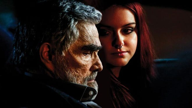 """Burt Reynolds, left, and Ariel Winter in a still from the movie """"Dog Years."""""""