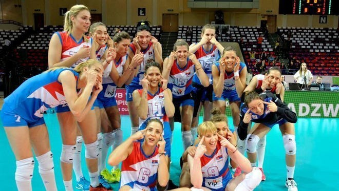 The Serbian volleyball team poses after winning the European championships that put them into the World championships next year in Japan.