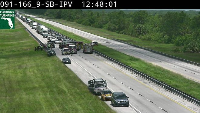 Traffic backs up on the southbound side of Florida's Turnpike on Wednesday, July 5, 2017, after a wreck near mile marker 167.