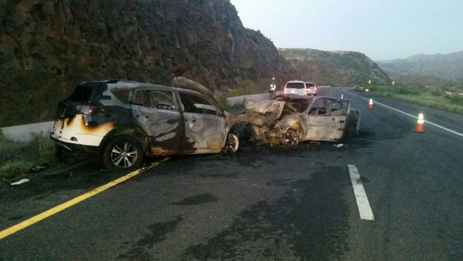 Authorities say bystanders pulled a wrong-way driver and three other injured people from these two vehicles following a head-on crash on Interstate 17 north of Phoenix on Aug. 15, 2017.