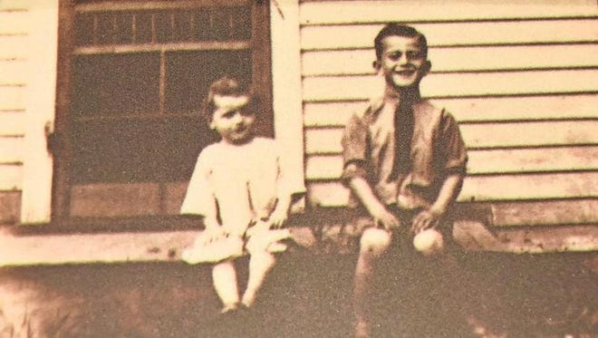 Wayne, whose given name was Marion Morrison, sits with his younger brother Robert on the porch stoop of the Brooklyn home where they lived in 1913-14. A large enclosed porch was added to the house in 1922, covering the front entrance.