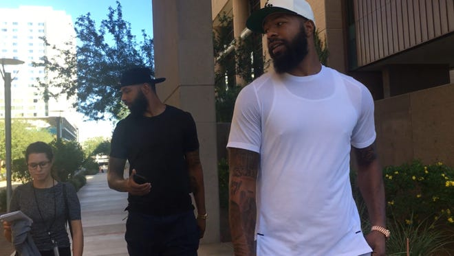 The Morris twins speak about the not-guilty verdict outside the Maricopa County Superior Courthouse on Oct. 3, 2017.