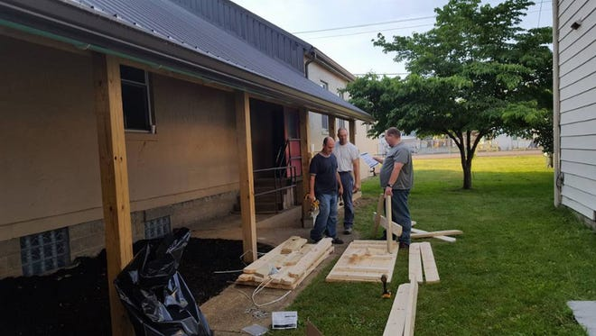 Roger McCreery, Sonny Scott, and Chris Baird work on renovations at Calvary Chapel.