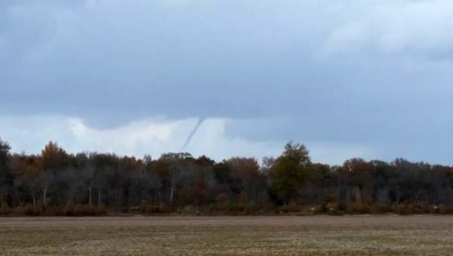This funnel cloud was associated with a weak shower. No damage was reported.