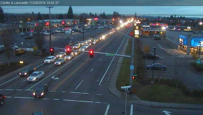 The image shows the intersection of Lancaster Drive and Center Street NE Wednesday evening.