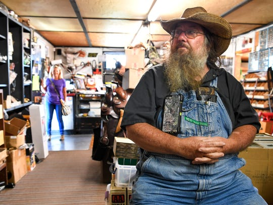 Larry Wells visits with people at the Saddle Shop in Triune, Tenn., Saturday, Aug. 26, 2017.