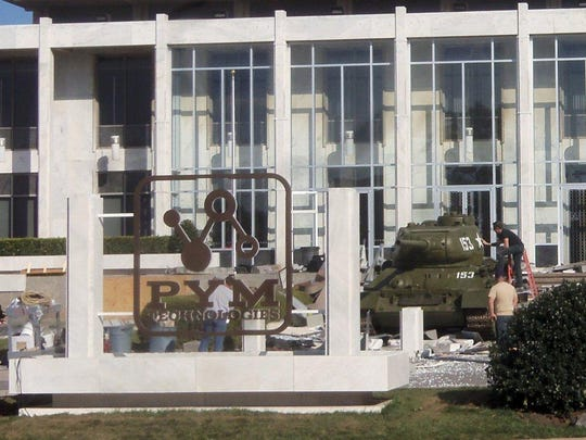 "The filming crew puts graphics on the Military Veterans Museum's Russian tank at the set of ""Ant-Man"" in Atlanta."