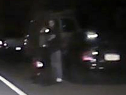 A suspect in a hit and run crash on Oct. 21 that resulted in the death of 52-year-old Lisa Thomas of Palmyra can be seen at the side of the road in this police image.