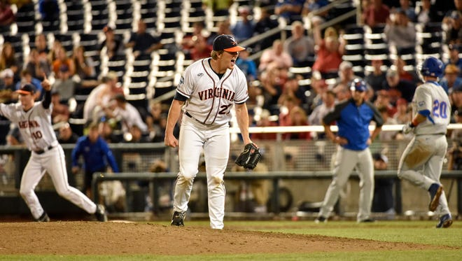 Virginia pitcher Josh Sborz celebrates after a 1-0 win over Florida in their College World Series game at TD Ameritrade Park in Omaha, Neb., on Tuesday