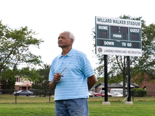 Willard Walker of Lansing stands on the infield of the new stadium at Risdale Park in Lansing named in his honor, Wednesday, Aug. 24, 2017.