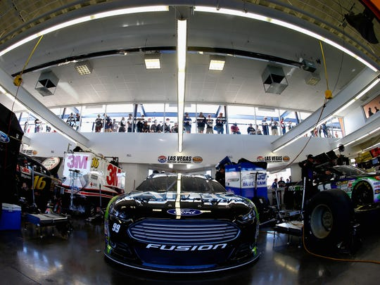 Watching the crews work is just part of the fun at the Neon Garage at Las Vegas Motor Speedway.