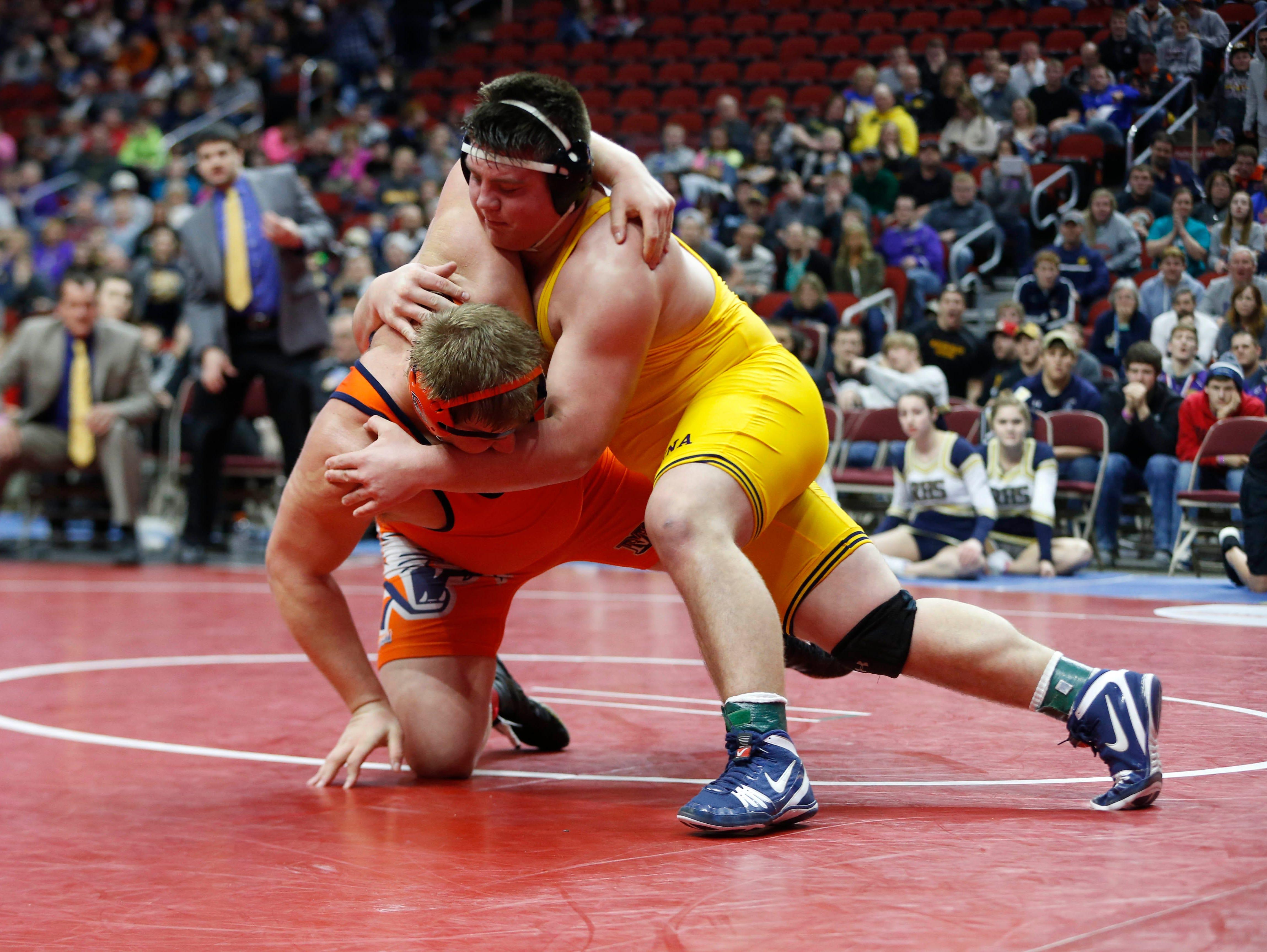 Manson Northwest's Tim Butcher (left) wrestles Regina's Jared Brinkman Saturday, Feb. 20, 2016 during the class 1A state wrestling tournament finals in Des Moines.