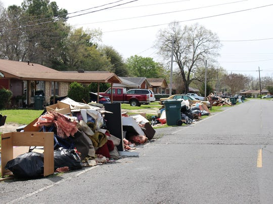 A street in East Parkview is lined with waterlogged furniture, insulation and other flood damaged items Wednesday.