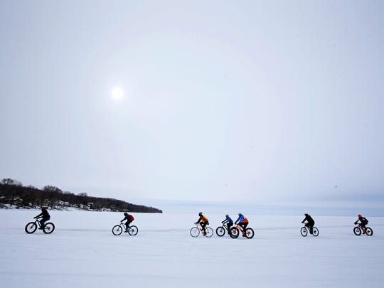 A winter sun offered little warmth to cyclists crossing Lake Winnebago near Faro Springs Road Beach during the 2017 Bike Across Bago.