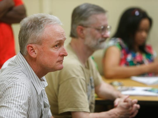 Kelly Myers, left, of Myers Hauling Company, listens