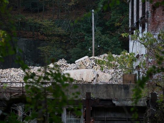Rubble lays where a 230-foot smokestack was imploded