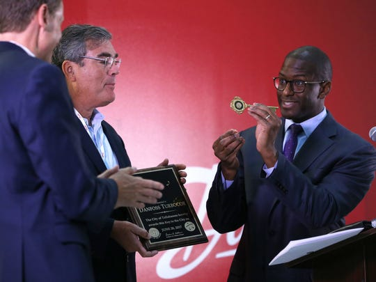 Mayor Andrew Gillum awards Danfoss executives with a key to the city, the first given to a corporation in Tallahassee, as the company officially opened its new facility Tuesday. Mayor Andrew Gillum awards Danfoss executives with a key to the city, the first given to a corporation in Tallahassee, as the company officially opened its new 22,000 square-foot Application Development Center Tuesday.