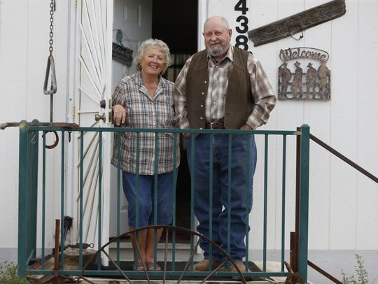 Linda and Mike Butler out on the front porch of their