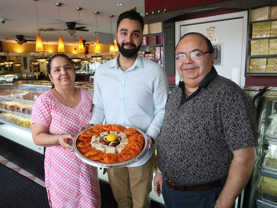 Babita (left) and Narinder Kumar with their son, Jay