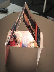 "An actual house of cards can be made by cutting mailers into 3"" x 5"" rectangles. Superglue is optional."