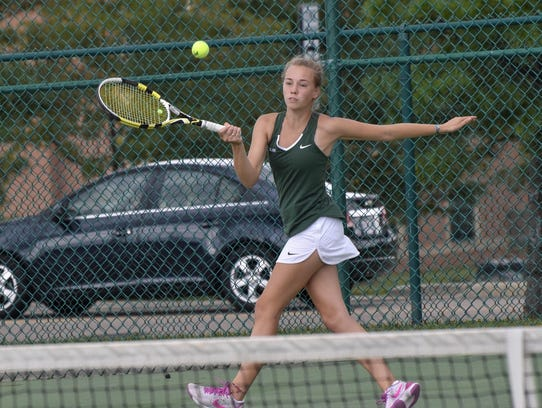 Ursuline's Gracie Estes lifts a forehand back for point