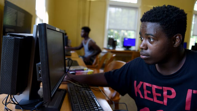 Erik Dawson uses the Internet at the North Branch Library because he doesn't have Internet at home.  He was applying for a job online.